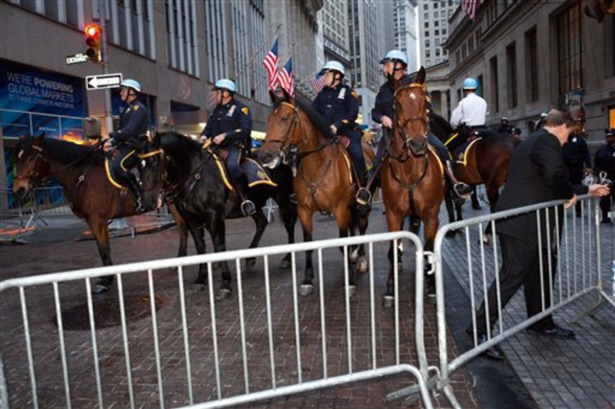 Mounted police officers near Zuccotti Park in lower Manhattan.   (AP)