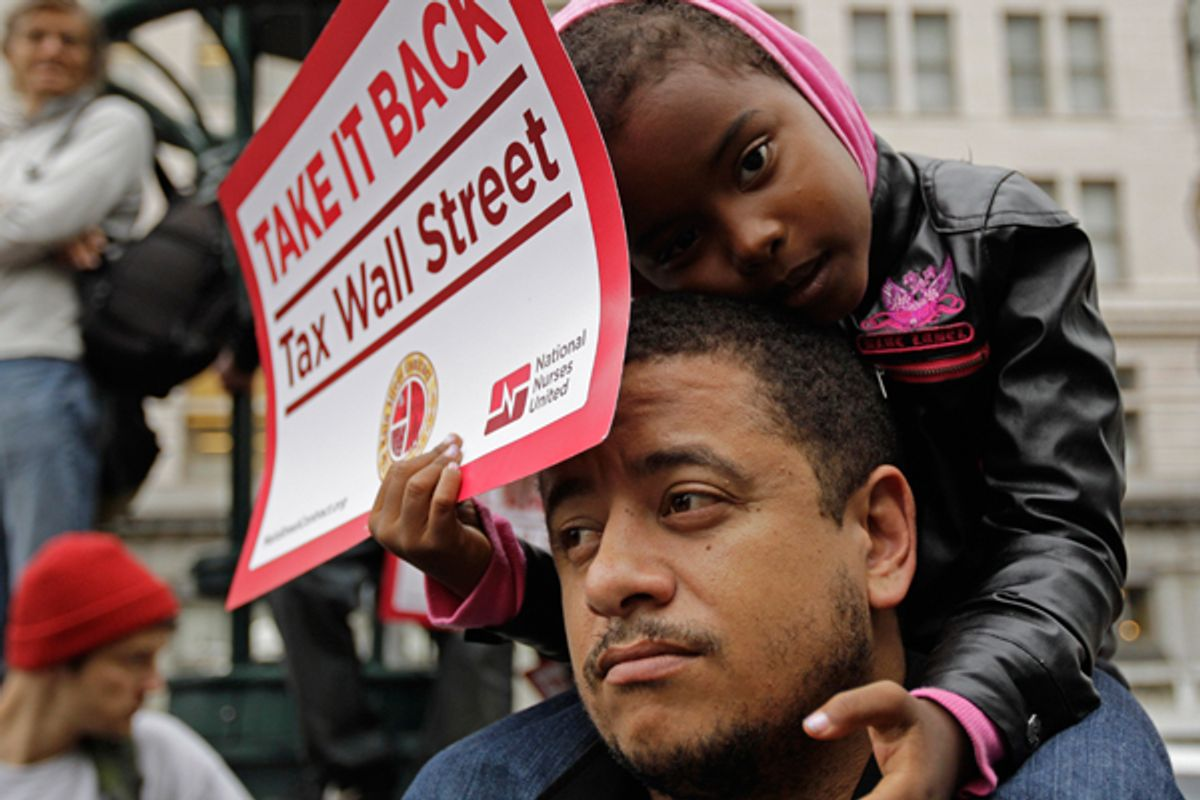 Kamayah Riley, 5, rests atop her father Manuel Riley's shoulders as he they participate in an Occupy Oakland rally.   (AP/Ben Margot)