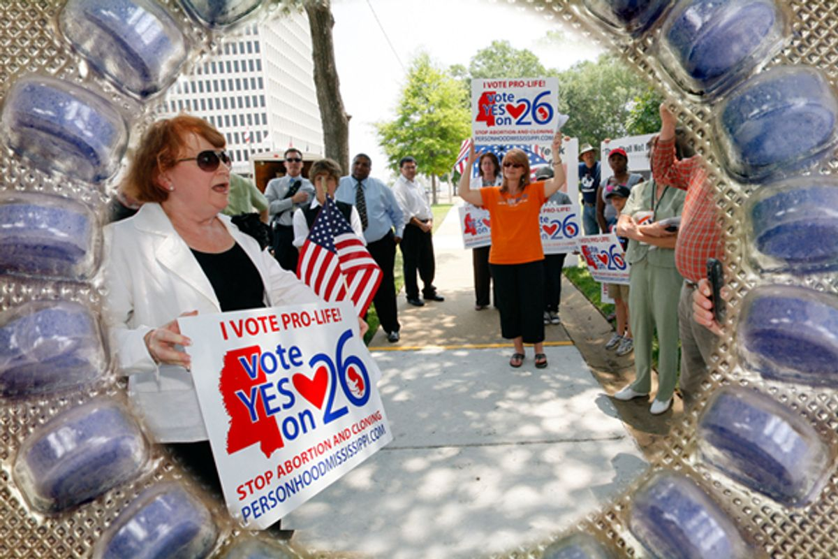 """At a June 6, 2011, rally, Dr. Beverly McMillan, president of Pro-Life Mississippi, left, thanks the people gathered in Jackson, Miss., for their support on the state's proposed """"personhood"""" amendment.   (iStockphoto/meltonmedia/AP/Rogelio V. Solis)"""