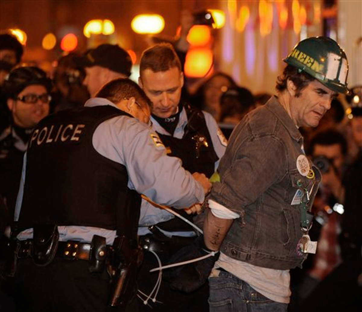 A protester gets arrested during an Occupy Chicago march and protest in Grant Park in Chicago, Sunday, Oct. 23, 2011    (AP Photo/Paul Beaty)