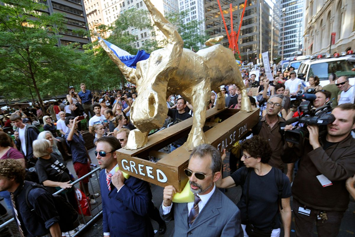 """A coalition of clergy carry a """"False Idol"""" to the Occupy Wall Street encampment in Zuccotti Park, Sunday, Oct. 9, 2011 in New York.                 (AP)"""