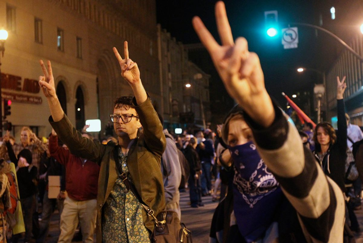 """A group of """"Occupy Wall Street"""" demonstrators flashing peace signs in Oakland    (Stephen Lam / Reuters)"""
