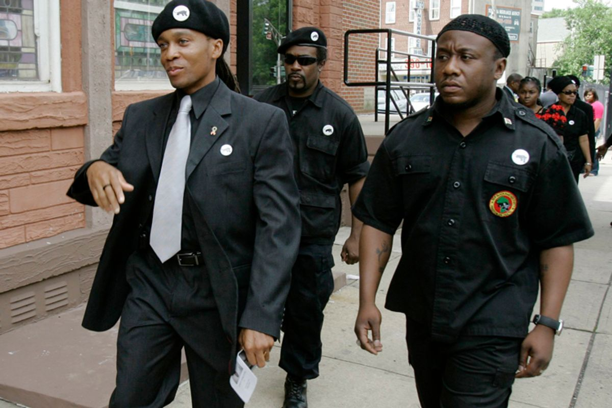 Members of the New Black Panther Party, including, Divine Allah, left, arrive for funeral services for 13-year-old shooting victim, Tamrah Leonard, at the Friendship Baptist Church in Trenton, N.J., Saturday, June 13, 2009.       (AP/Mike Derer)
