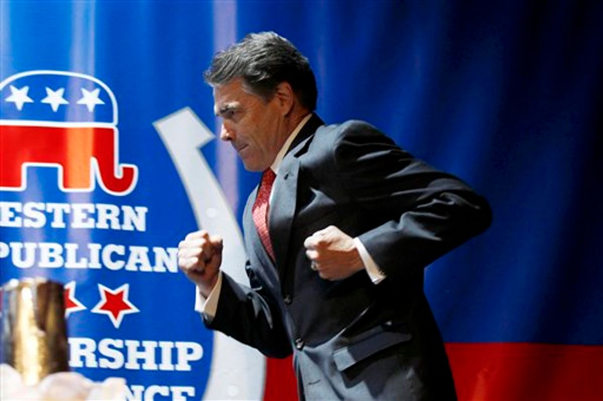Republican presidential candidate, Texas Gov. Rick Perry, runs prior to delivering a keynote address during the Western Republican Leadership Conference, Wednesday, Oct. 19, 2011, in Las Vegas. (AP Photo/Isaac Brekken)   (AP)