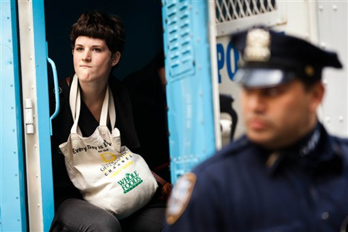 An Occupy Wall Street protester is arrested for allegedly trespassing on Citibank property near Washington Square Park, Saturday, Oct. 15, 2011, in New York        (AP Photo/John Minchillo)