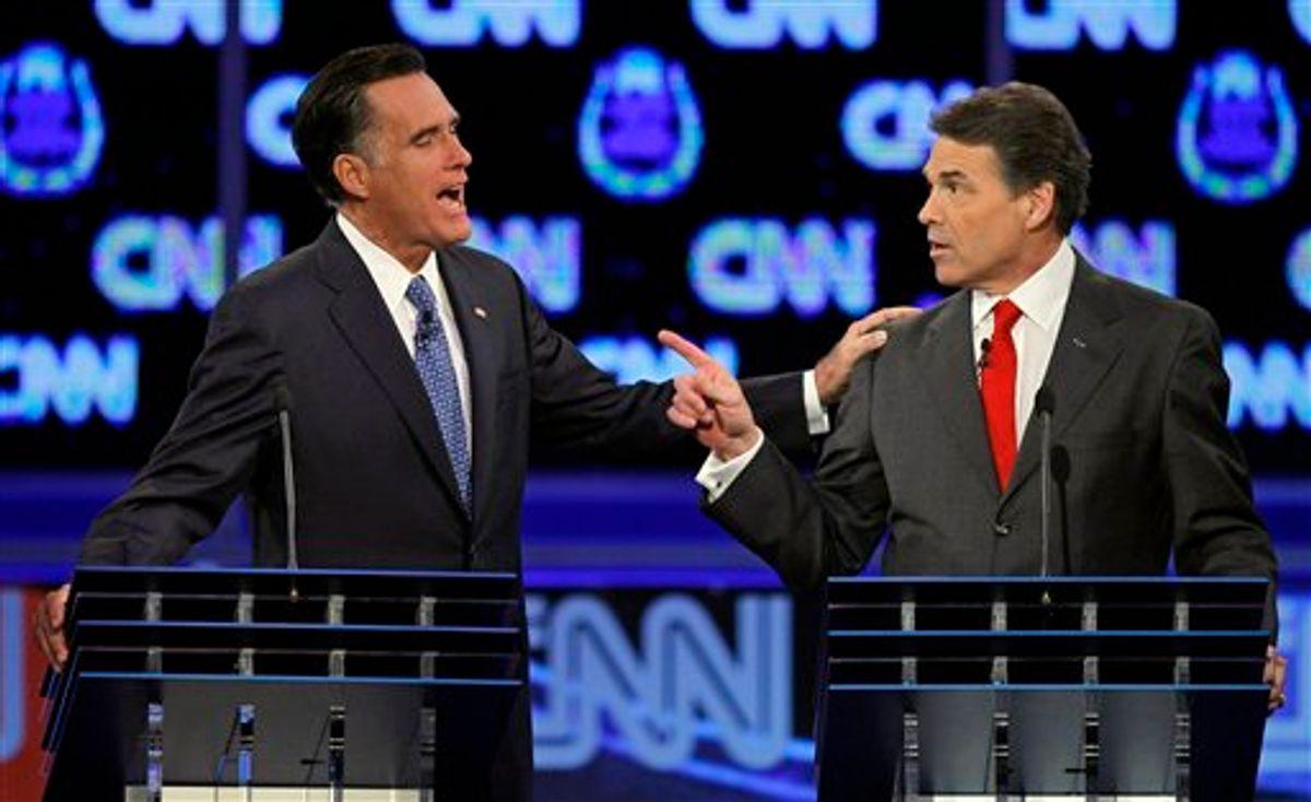 Republican presidential candidates former Massachusetts Gov. Mitt Romney, left, and Texas Gov. Rick Perry speak during a Republican presidential debate Tuesday, Oct. 18, 2011, in Las Vegas.  (AP Photo/Chris Carlson)     (AP)