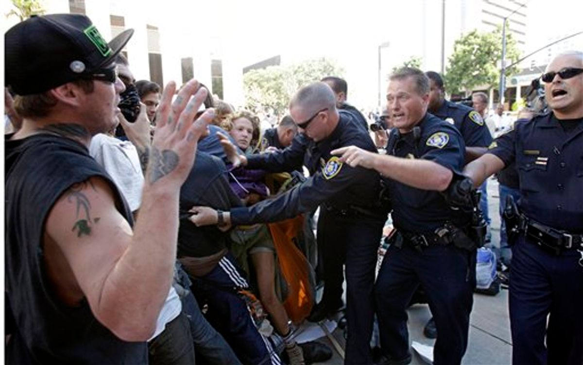 San Diego Police clash with demonstrators at the Civic Center Plaza Friday, Oct. 14, 2011 in San Diego.     (AP/Lenny Ignelzi)