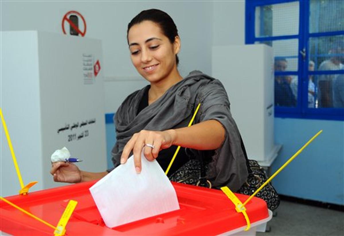 A Tunisian casts her vote in la Marsa near Tunis, Sunday Oct. 23, 2011  (AP Photo/Hassene Dridi)