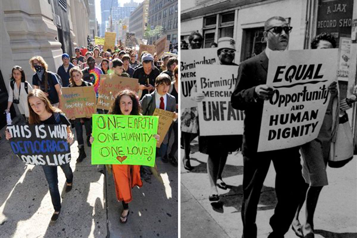 Protesters with Occupy Wall Street march from Zuccotti Park to Washington Square Park in New York, Oct. 8, 2011. Right: Al Hibbler, right, blind black singer, leads a line of sign carrying demonstrators in downtown Birmingham, AL, April 10, 1963.    (AP)