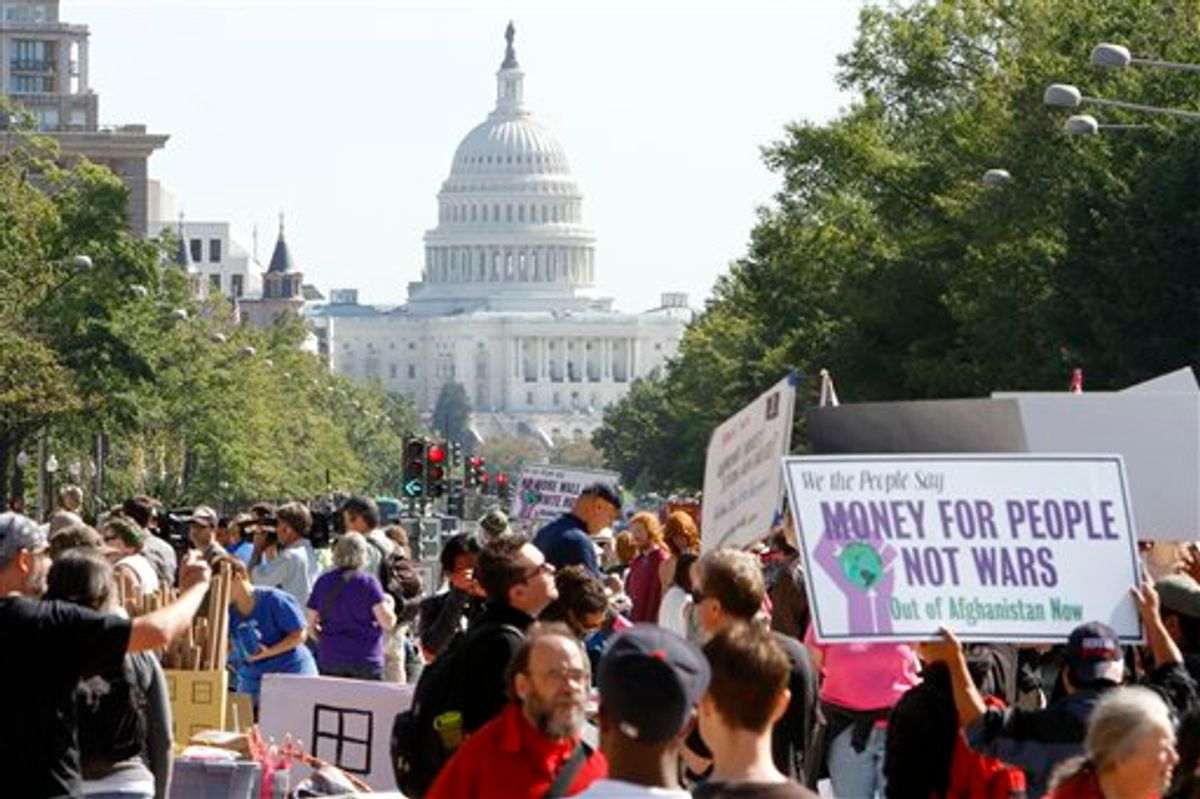 """With the Capitol in the background, several groups """"occupy"""" Freedom Plaza in Washington, last fall.  (AP/Jacquelyn Martin)"""