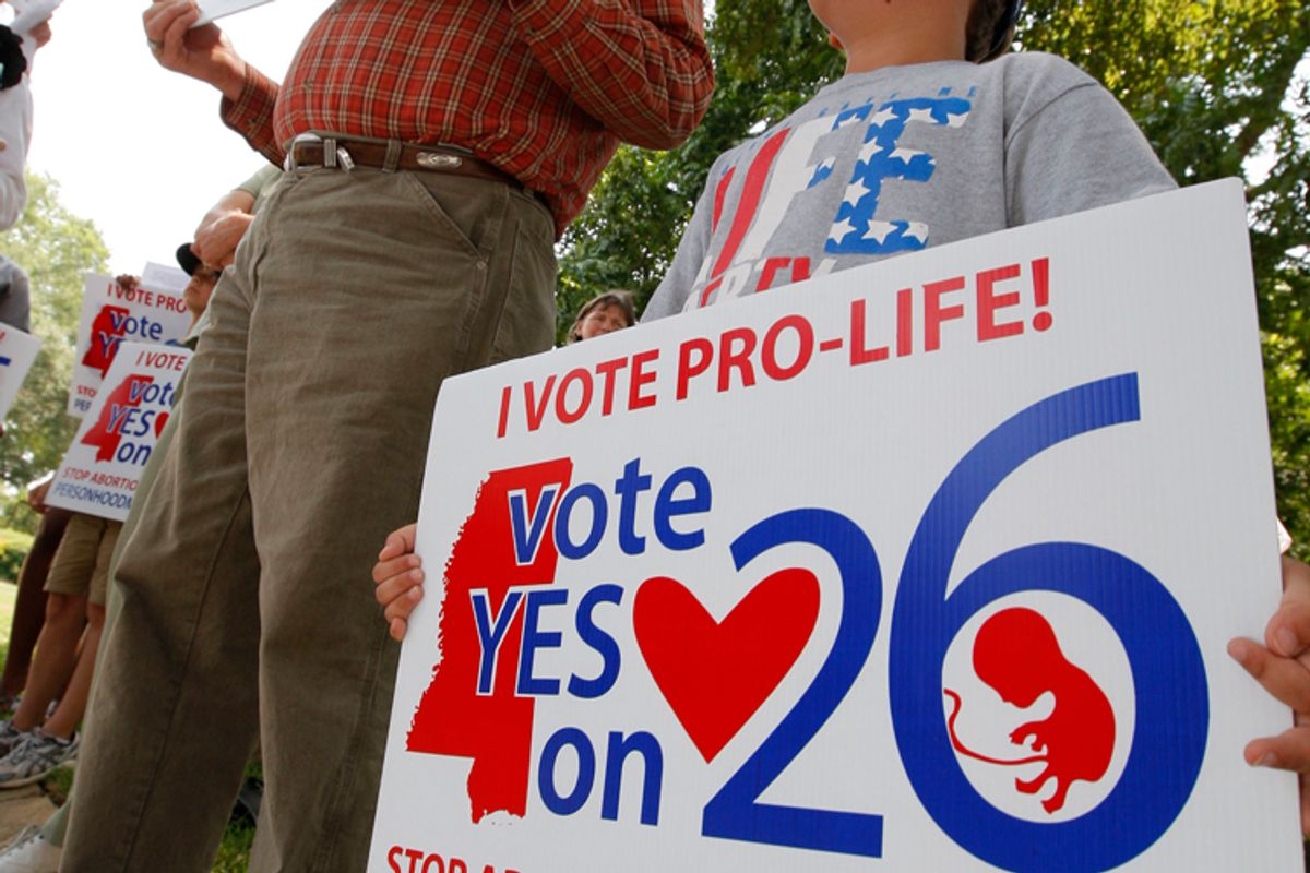 Protestors during a prayer rally for the Personhood Amendment at the Capitol in Jackson, Mississippi       (Rogelio V. Solis/AP)