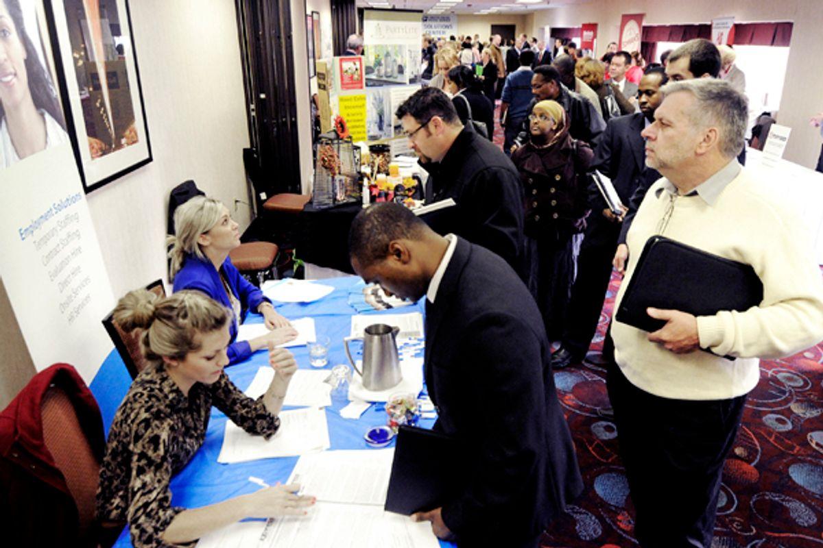 Job seekers attend the Minneapolis Career Fair held Wednesday, Nov. 2, 2011, in Bloomington, Minn.       (AP/Jim Mone)