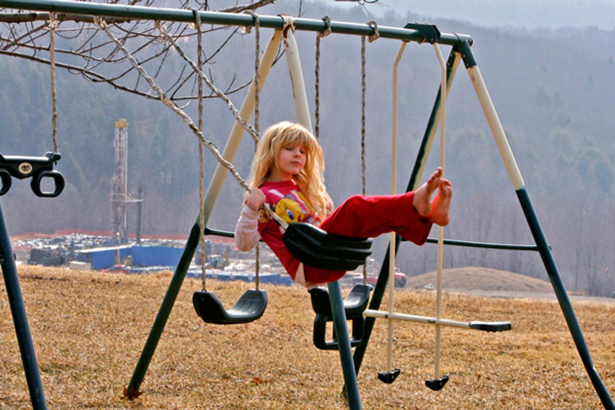 Rachel Farnelli rides on her backyard swing that overlooks the Gesford #3 natural gas well in Dimock, Pennsylvania, in this March 7, 2009 file photo.      (Tim Shaffer / Reuters)