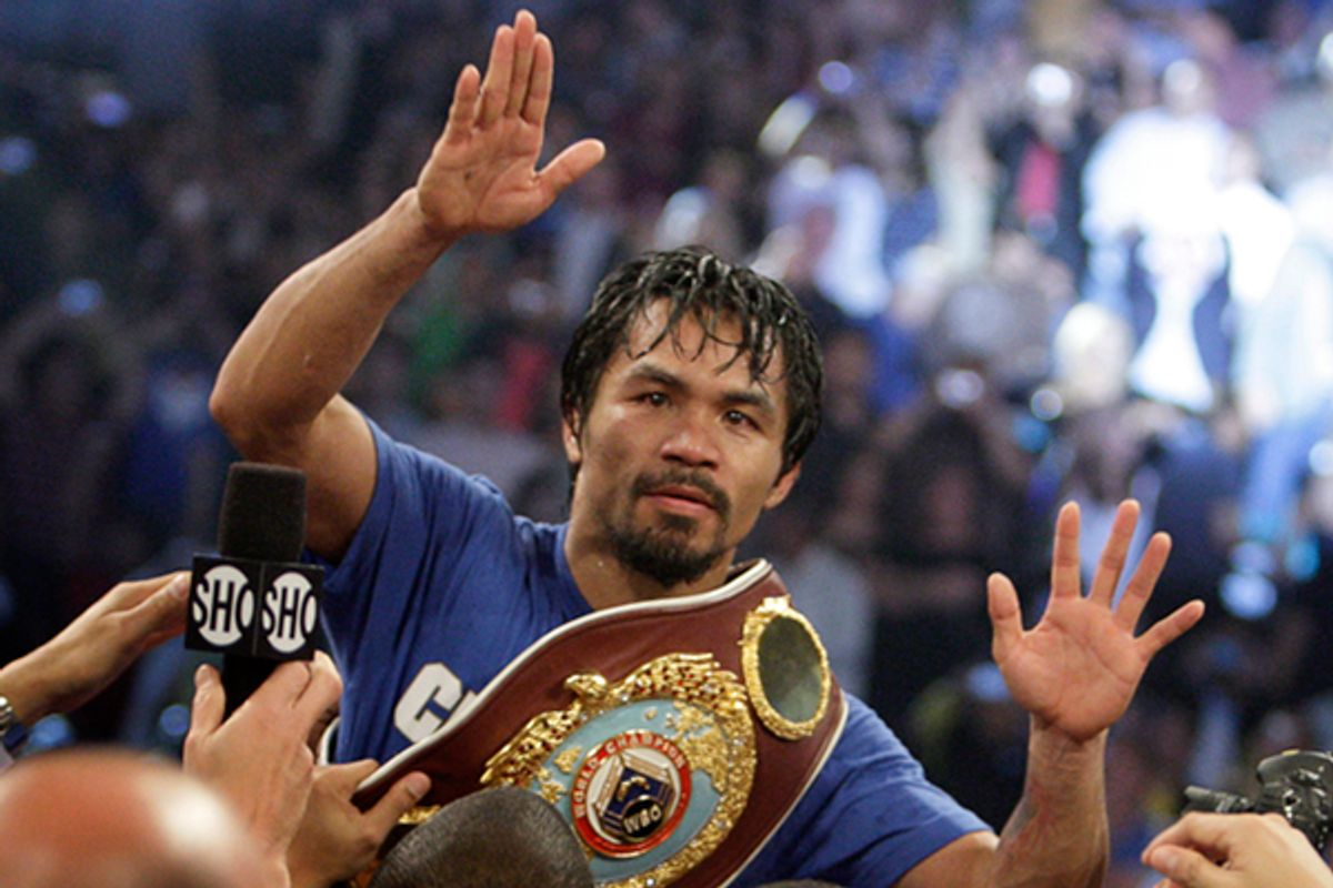 Manny Pacquiao of the Philippines celebrates his victory over Shane Mosley of the U.S. after the WBO welterweight title fight at the MGM Grand Garden Arena in Las Vegas on May 7, 2011.     (Steve Marcus / Reuters)
