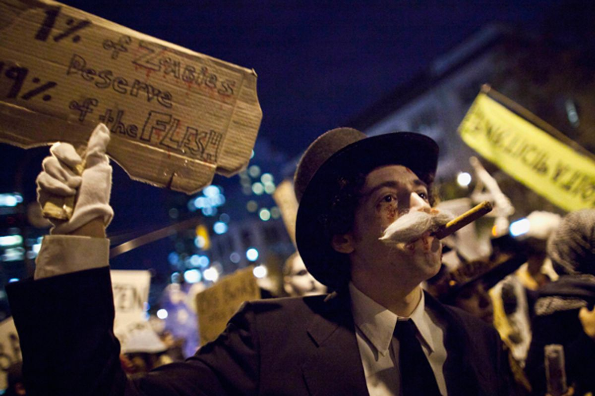 An Occupy Wall Street protestor in New York    (Andrew Burton / Reuters)