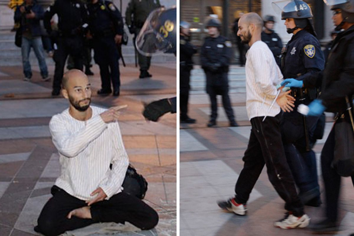 Police arrested Pancho Ramos Stierle as he was meditating at the Occupy Oakland encampment on Monday, Nov. 14, 2011.        (Ap/Paul Sakuma)