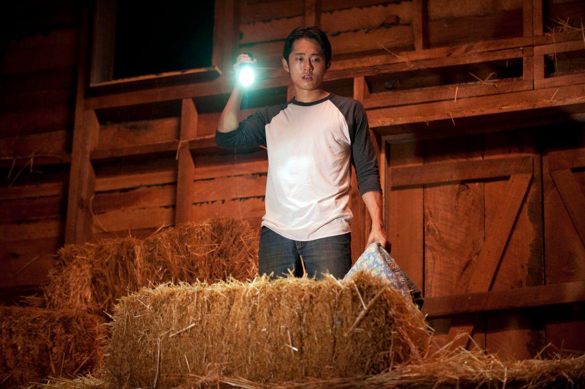 "Glenn (Steven Yeun) makes a horrifying discovery in ""The Walking Dead.""        (Gene Page/AMC)"
