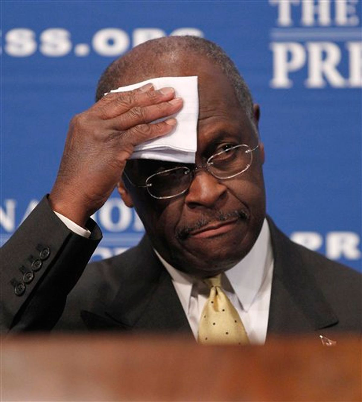 """Republican presidential candidate, Herman Cain wipes his forehead before answering questions at the National Press Club in Washington, Monday, Oct., 31, 2011. Denying he sexually harassed anyone, Cain said Monday he was falsely accused in the 1990s while he was head of the National Restaurant Association, and he branded revelation of the allegations a """"witch hunt."""". (AP Photo/Pablo Martinez Monsivais)  (AP)"""