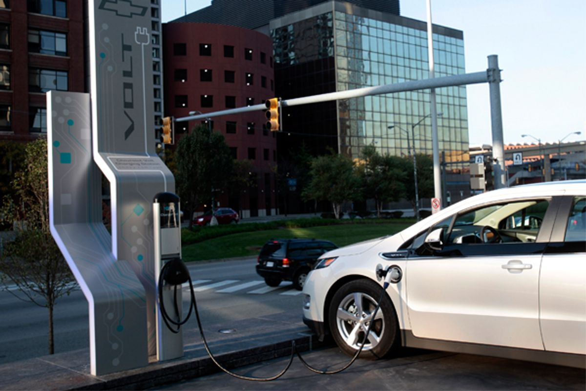 A Chevrolet Volt sits plugged into an electric vehicle charging station outside General Motors world headquarters in Detroit.        (Reuters/Rebecca Cook)