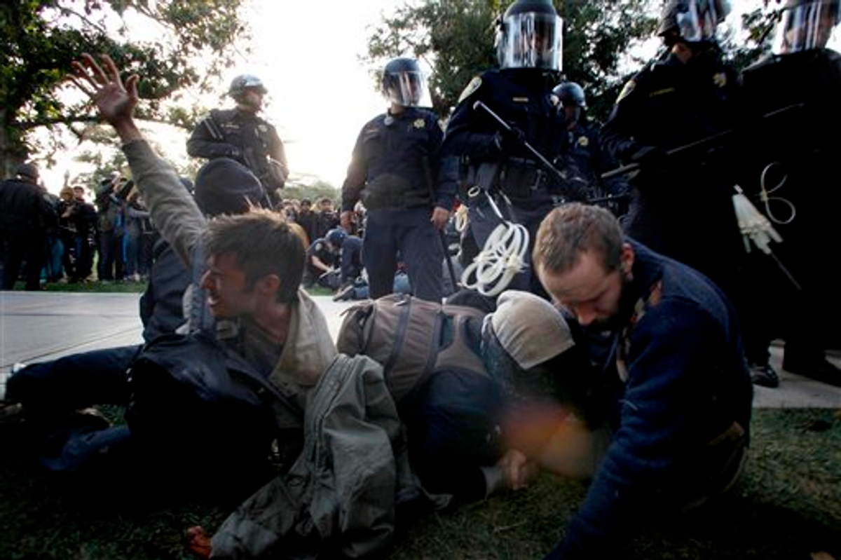 Protesters at University of California, Davis react after being pepper sprayed by police on Friday, November 18, 2011     (AP Photo/The Enterprise, Wayne Tilcock)