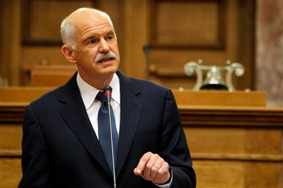 Greek Prime Minister George Papandreou addresses Socialist members of parliament in Athens, Monday, Oct. 31, 2011.      (AP/Thanassis Stavrakis)
