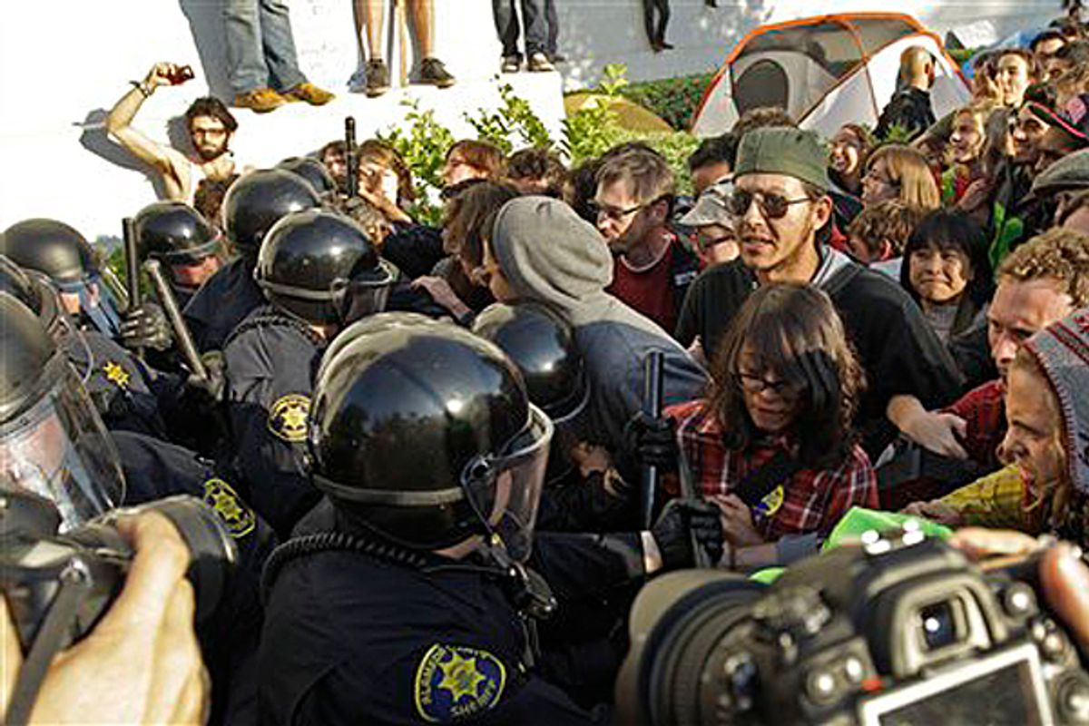 Police in riot gear clash with student activists in front of Sproul Hall on the University of California at Berkeley campus Wednesday, Nov. 9, 2011, in Berkeley, Calif.      (AP/Ben Margot)