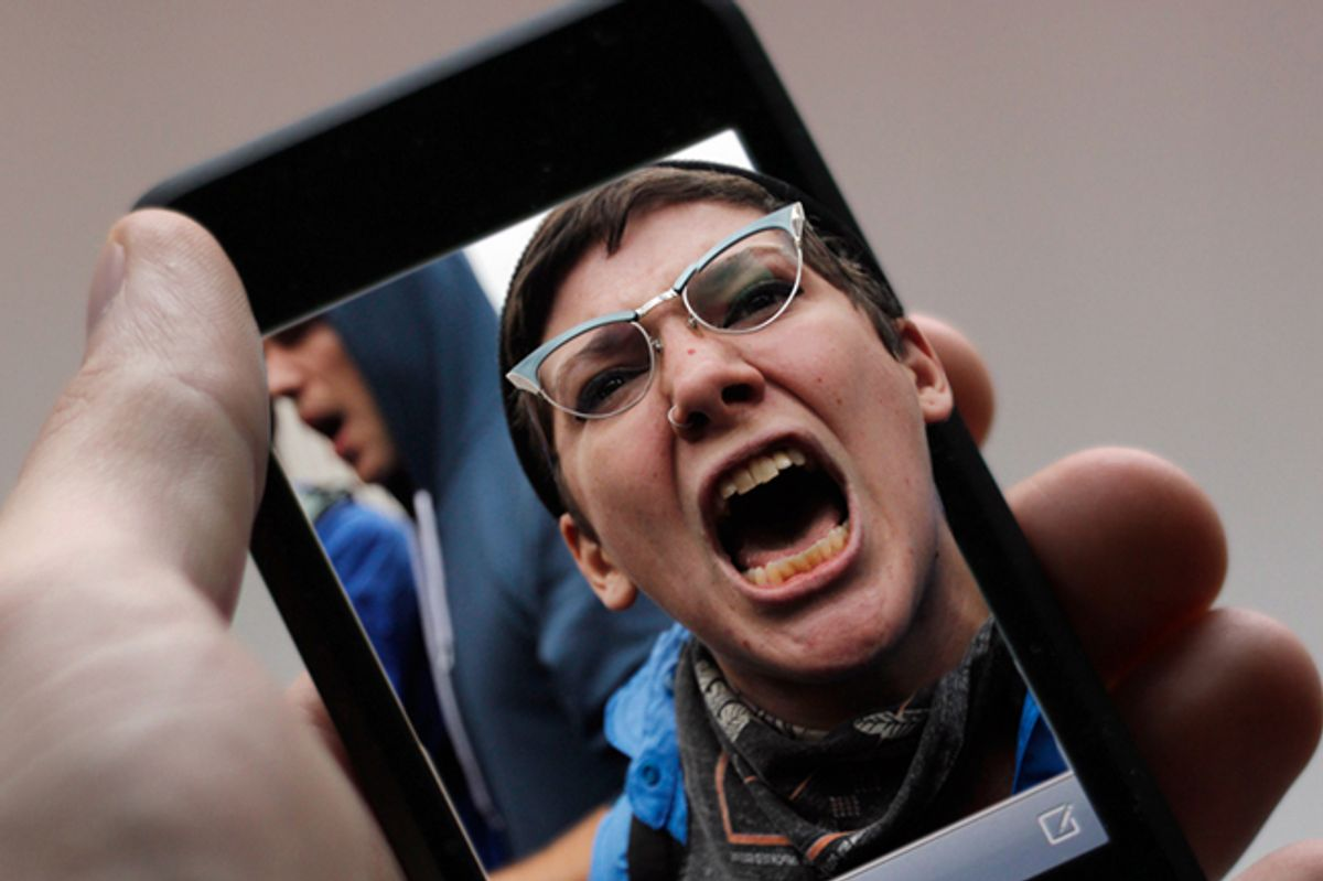 A protester chants during an Occupy Wall Street march in New York.          (<a href='http://www.shutterstock.com/gallery-4961p1.html'>J. Henning Buchholz</a> via <a href='http://www.shutterstock.com/'>Shutterstock</a>/Reuters)