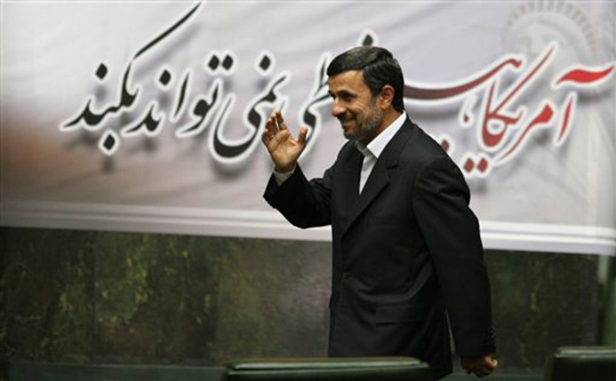 Iranian President Mahmoud Ahmadinejad, waves, as he arrives to attend an open session of parliament in Tehran, Iran, Tuesday, Nov. 1, 2011.    (AP/Vahid Salemi)