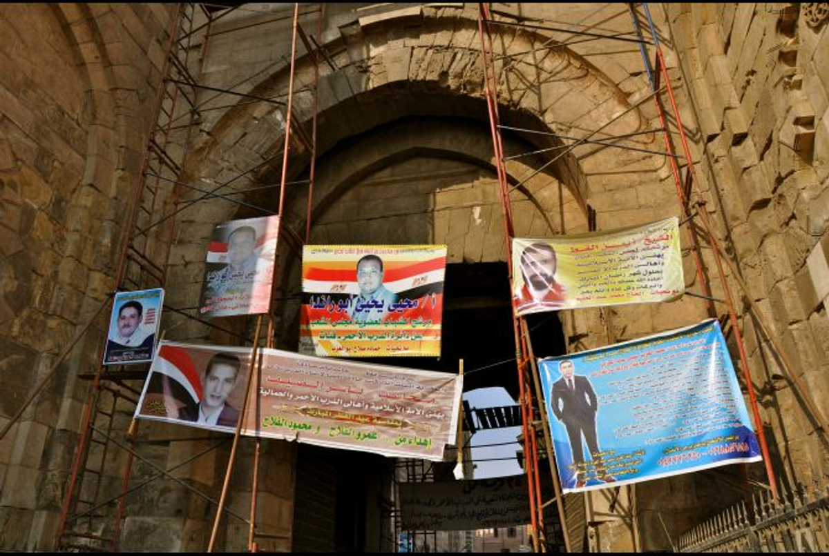 Advertisements for parliamentary candidates hang from scaffolding in Cairo in October 2011    (Lauren E. Bohn/GlobalPost)