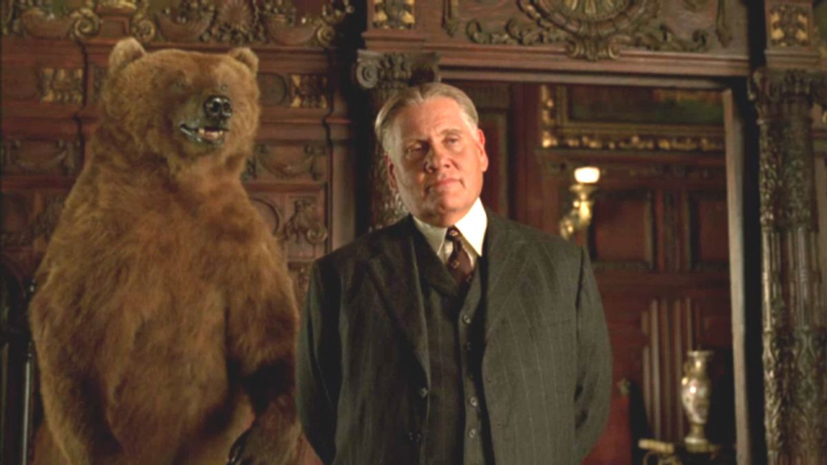 """Two of a kind: The Commodore's stuffed grizzly looms behind Philadelphia gangster Manny Horvitz (Williams Forsythe) on """"Boardwalk Empire.) (HBO)"""