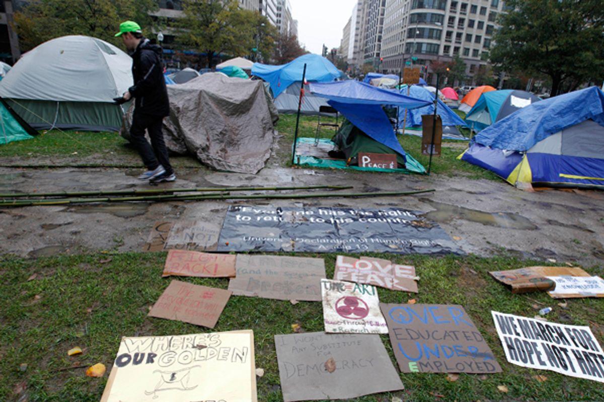 A demonstrator walks through the Occupy DC McPherson Square camp.    (Reuters/Jose Luis Magaua)
