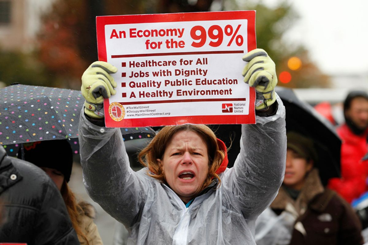 Occupy K Street demonstrators protest on a street in Washington    (Jose Luis Magaua / Reuters)