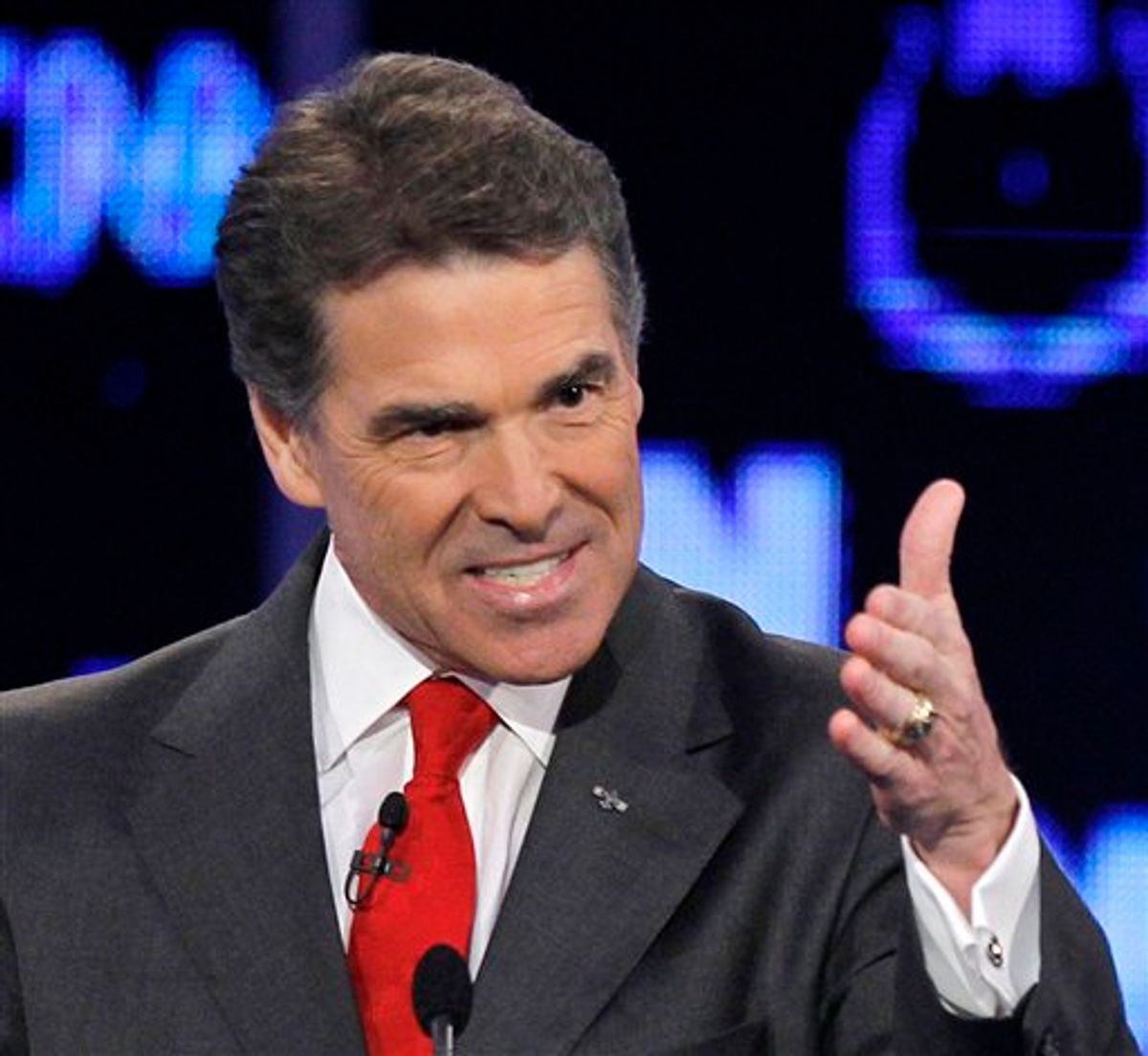 FILE - In this Oct. 18, 2011 file photo, Republican presidential candidate Texas Gov. Rick Perry makes a point during a Republican presidential debate in Las Vegas. (AP Photo/Chris Carlson, File)         (AP)