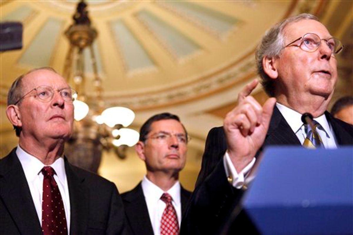 Senate Minority Leader Mitch McConnell, R-Ky., right, accompanied by, from left, Sen. Lamar Alexander, R-Tenn., Sen. John Barrasso, R-Wyo., gestures during a news conference on Capitol Hill in Washington, Tuesday, Oct. 18, 2011.          (AP/Jacquelyn Martin)