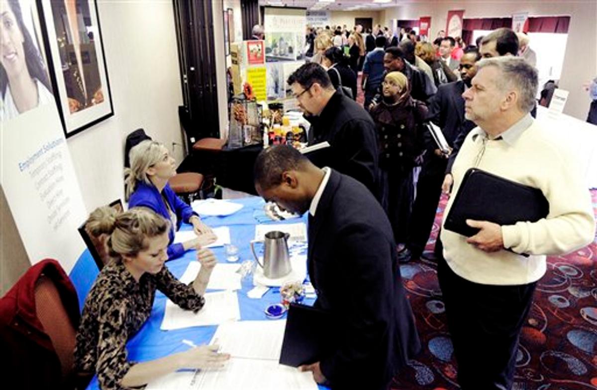 Job seekers attend the Minneapolis Career Fair held Wednesday, Nov. 2, 2011, in Bloomington, Minn.   (AP Photo/Jim Mone)
