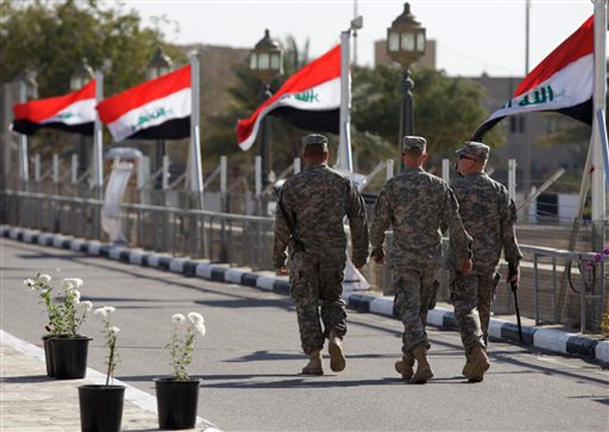 Iraqi flags wave as U.S. soldiers leave Al Faw palace at Camp Victory on Thursday, Dec. 1, 2011   (AP Photo/Khalid Mohammed)