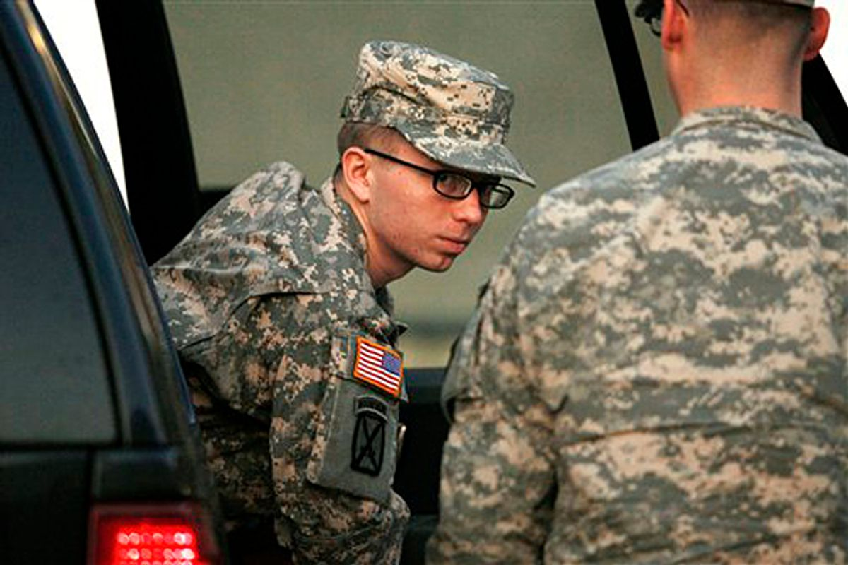 Army Pfc. Bradley Manning is escorted from a security vehicle to a courthouse in Fort Meade, Md., Monday, Dec. 19, 2011, for a military hearing         (AP/Patrick Semansky)