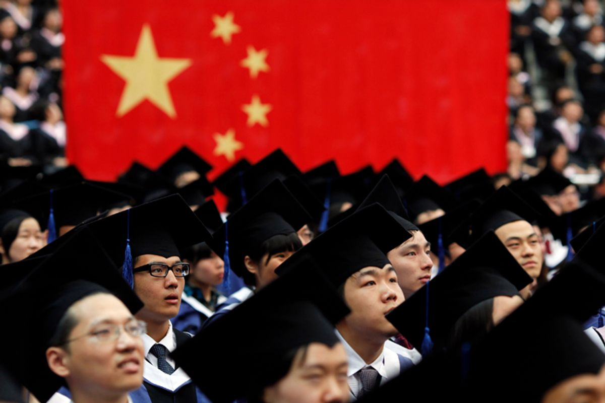 Students attend their college graduation ceremony in Shanghai's Fudan University  July 2, 2011.              (Carlos Barria / Reuters)