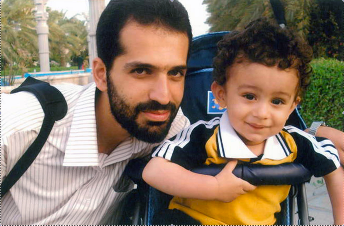 This undated photo released by Iranian Fars News Agency, claims to show Mostafa Ahmadi Roshan, who they say was killed in a bomb blast in Tehran, Iran, on Wednesday, Jan. 11, 2012, next to his son.    (AP)
