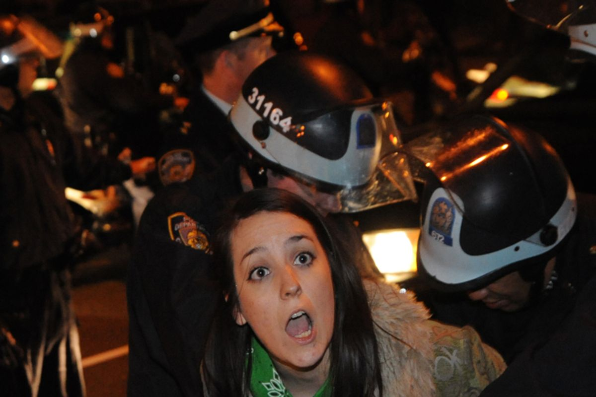 An Occupy Wall Street protester is arrested by police Sunday Jan. 1, 2012 in New York.        (AP/Stephanie Keith)