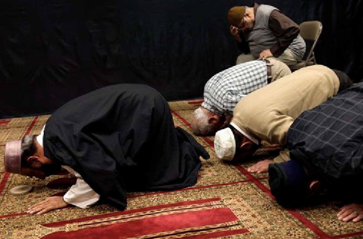 Imam Malik Sakhawat Hussain, left, leads prayers at the Al-Mahdi Foundation in New York, Wednesday, Feb. 1, 2012. The New York Police Department recommended increasing surveillance of thousands of Shiite Muslims and their mosques based solely on their religion,       (AP Photo/Seth Wenig)