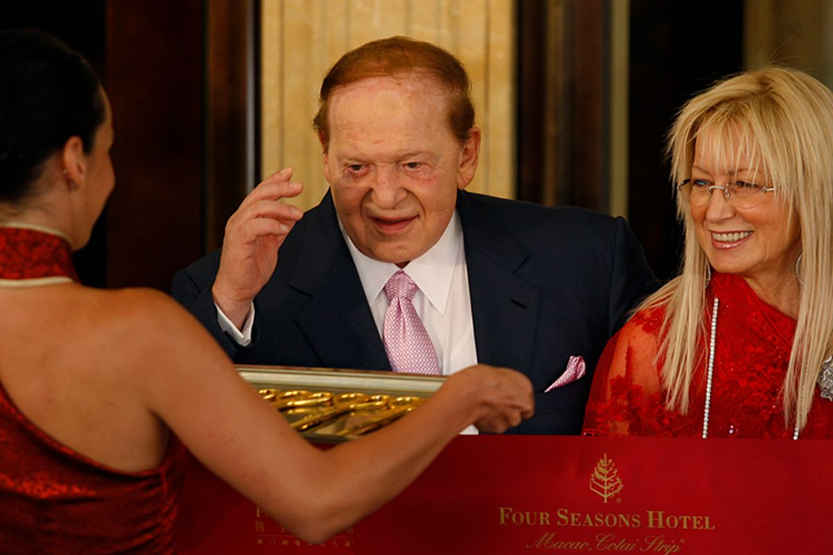 Sheldon Adelson, chief executive of Las Vegas Sands Corporation, and his wife Miriam attend the ribbon cutting of the Four Seasons Macao hotel and casino in Macau.             (Bobby Yip / Reuters)