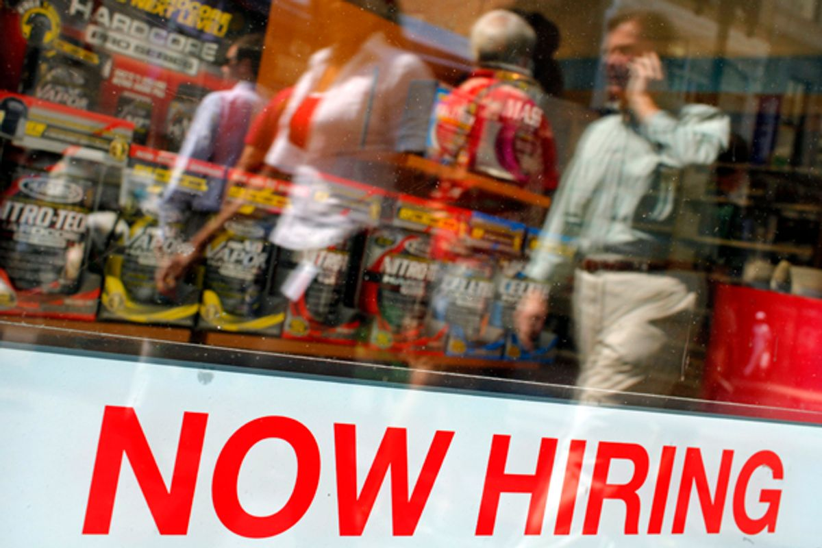 """Pedestrians walk past a """"Now Hiring"""" sign in the window of a GNC shop      (Brian Snyder / Reuters)"""