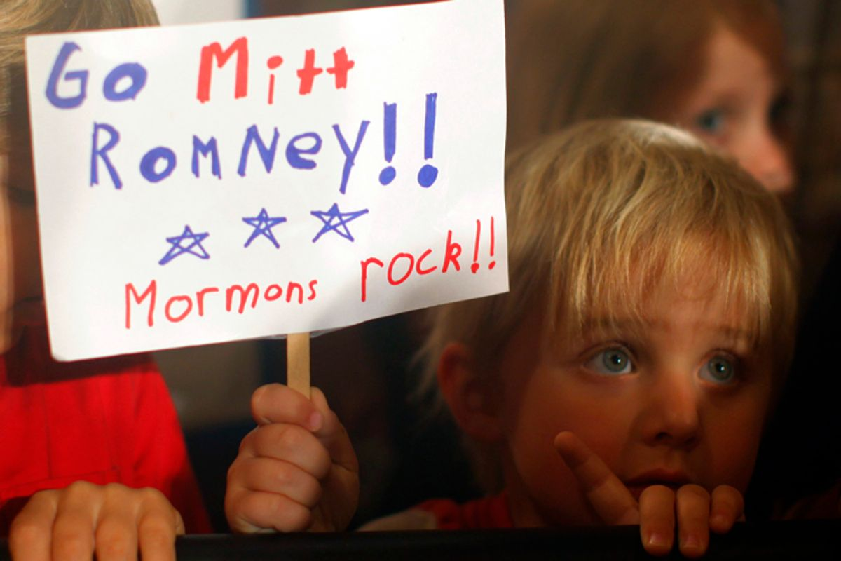 Three-year-old Dean Call holds a sign as Mitt Romney speaks during a campaign rally in Columbia, S.C., on Jan. 11, 2012.         (Brian Snyder / Reuters)