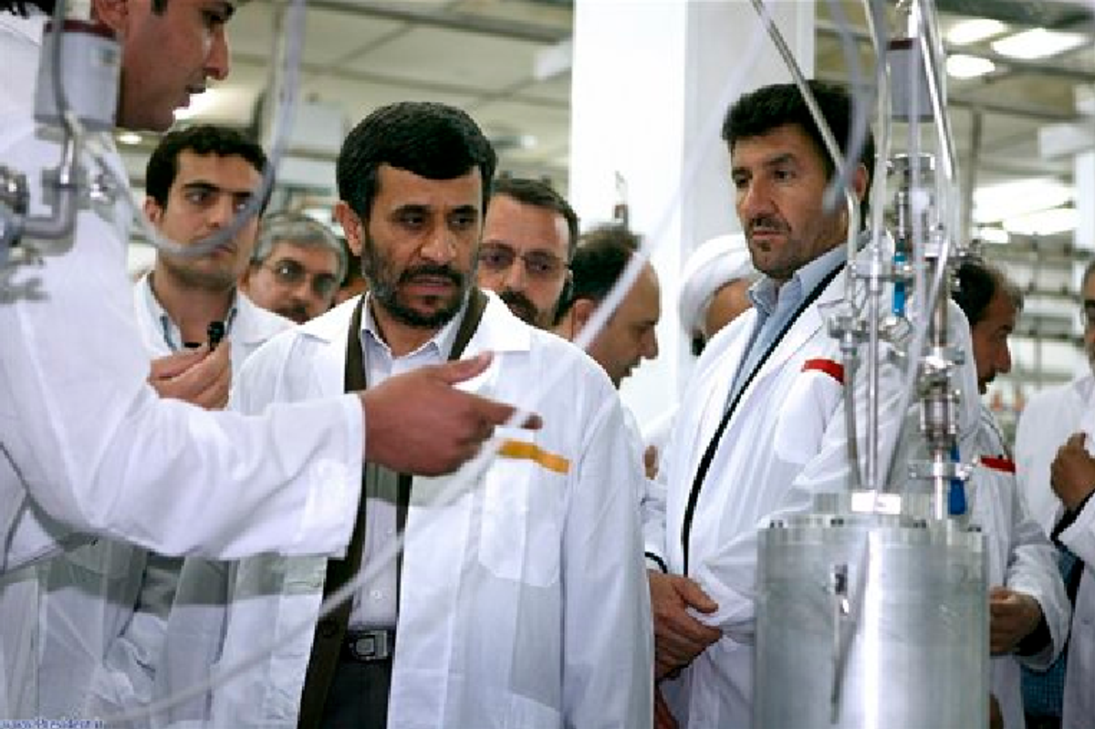 In this April 8, 2008, photo released by the Iranian President's Office, Iranian President Mahmoud Ahmadinejad, center, listens to a technician during his visit of the Natanz Uranium Enrichment Facility. (AP Photo/Iranian Presidents office, File)