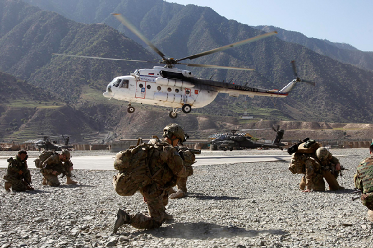 A helicopter lands near U.S. soldiers at the Forward Operating Base Bostic  in Kunar, Afghanistan     (Reuters/Erik de Castro)