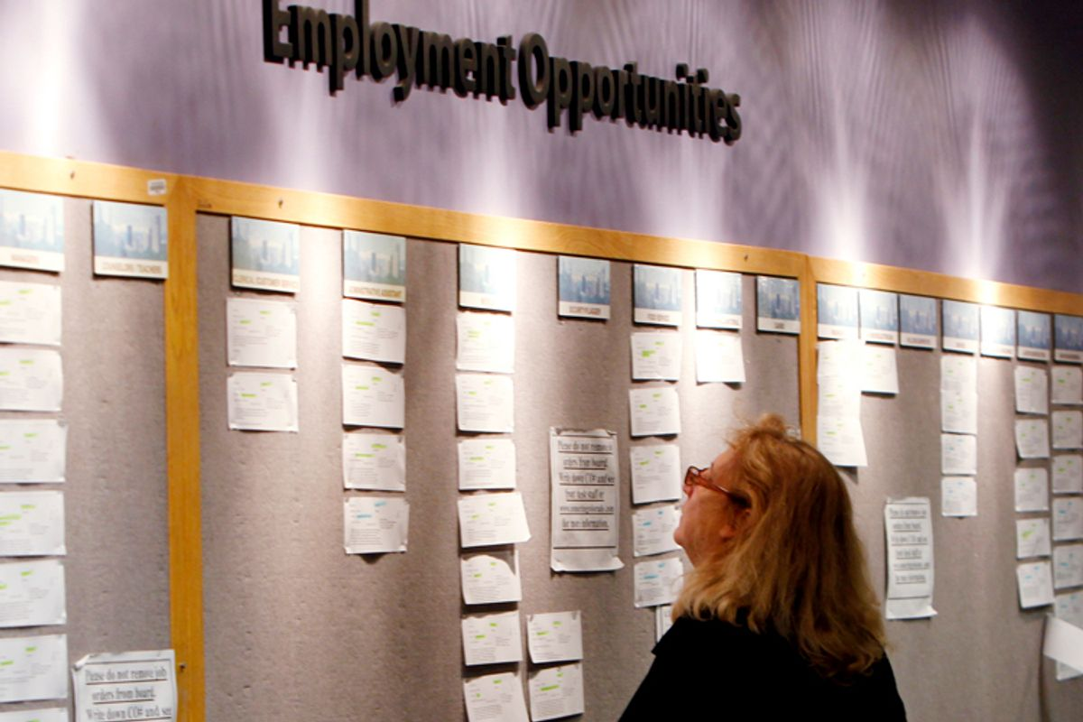 Lori Kamlet looks at posted employment opportunities at a Denver employment office.      (AP)