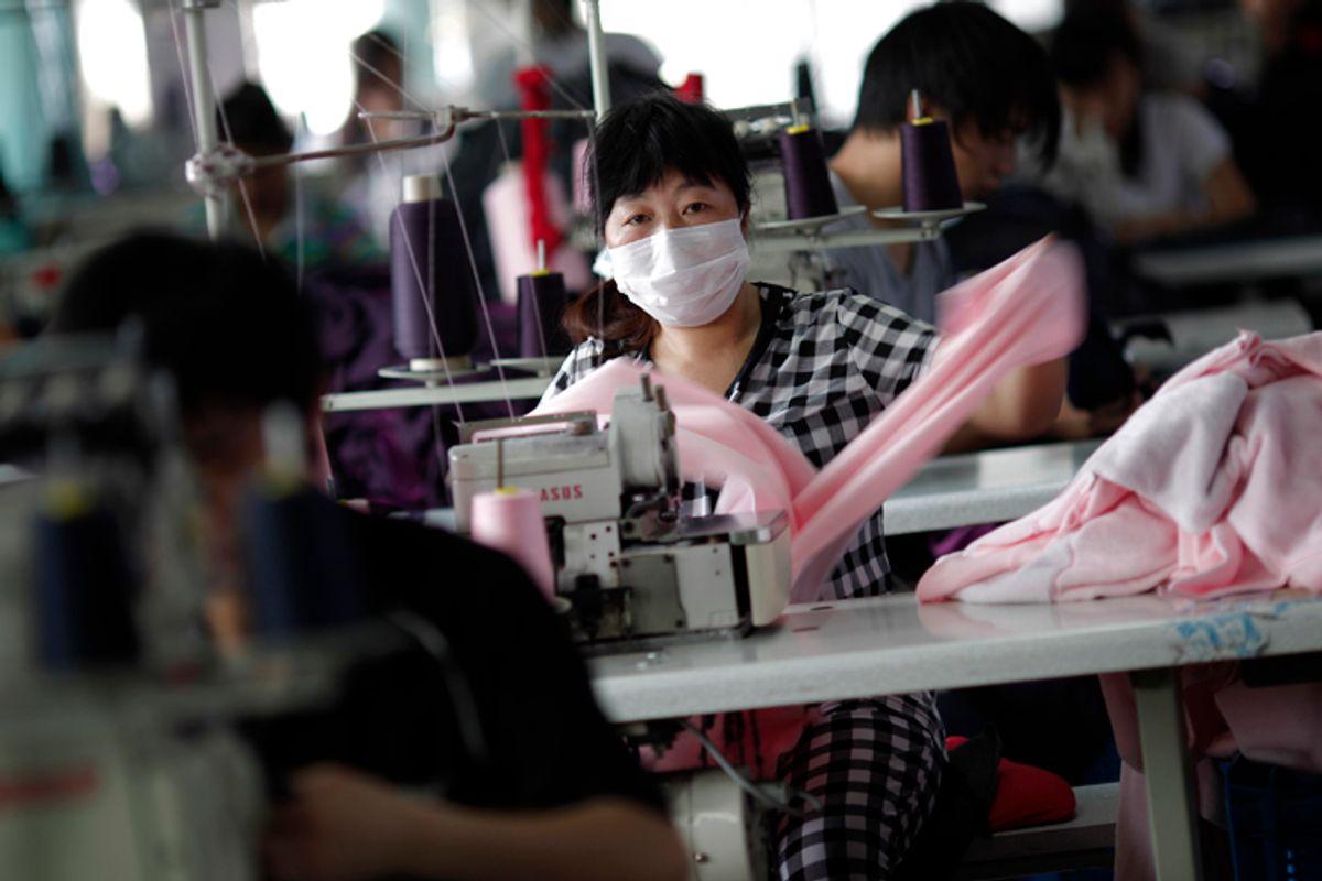 An employee works at the Yiwu Lianfa clothing factory in Yiwu, Zhejiang province, June 8, 2011      (Carlos Barria / Reuters)