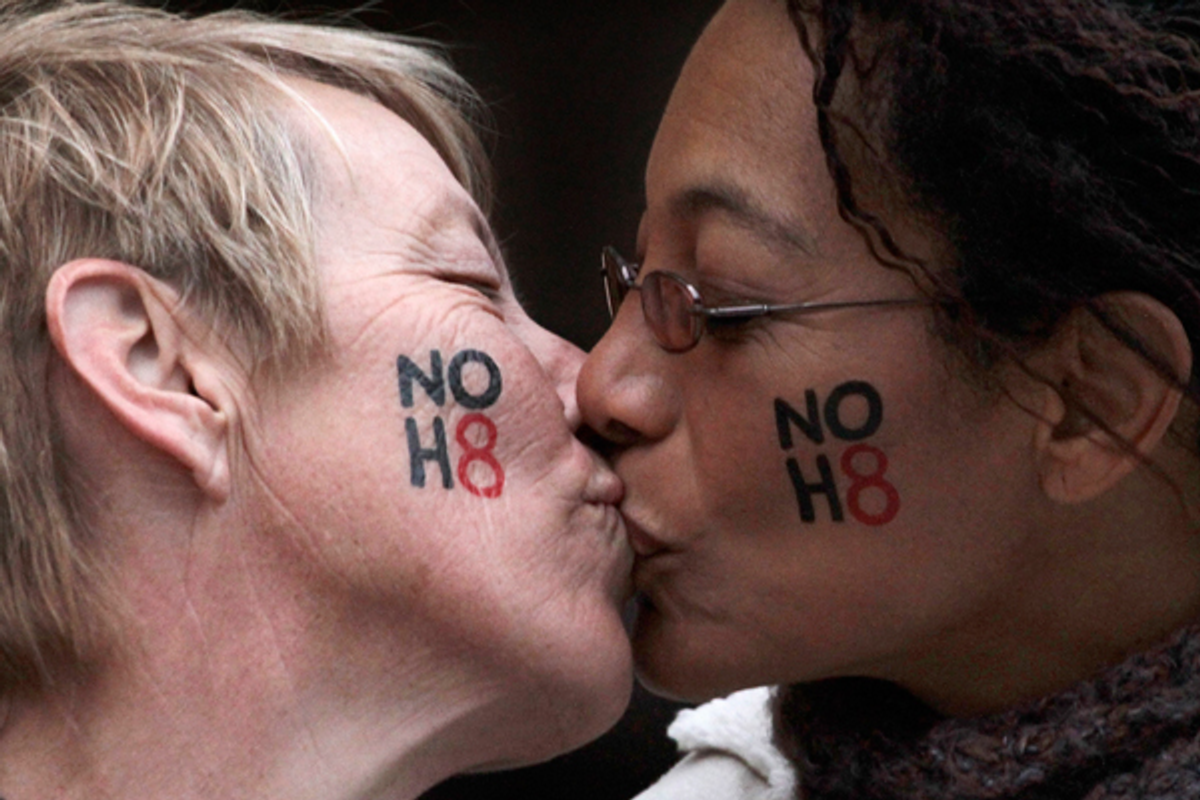 Lori Campbell (L) and Maja Roble, who are engaged, kiss at a celebration rally for Tuesday's ruling on Proposition 8 in West Hollywood, California February 7, 2012  (Reuters/Jonathan Alcorn)