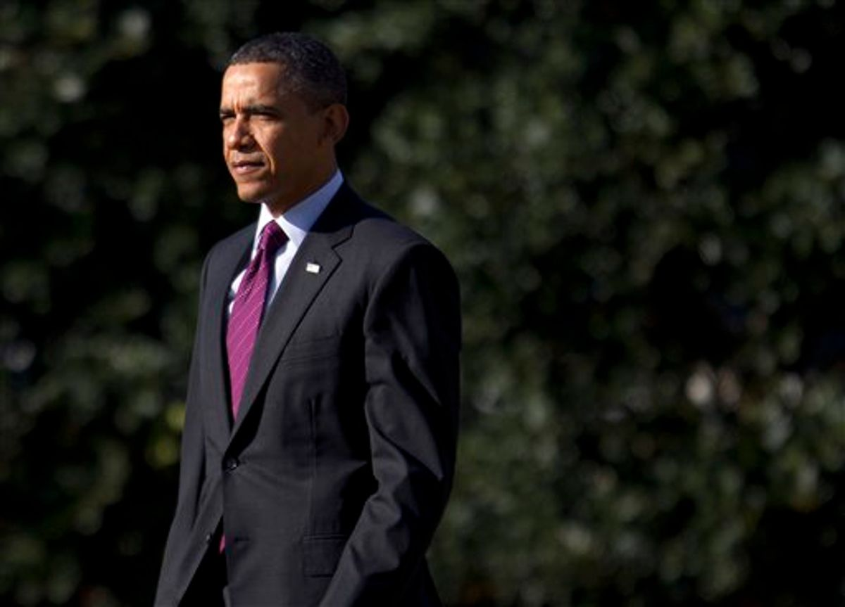 President Barack Obama walks to Marine One on the South Lawn of the White House in Washington, Wednesday, Jan. 25, 2012.  (AP Photo/Evan Vucci)        (AP)